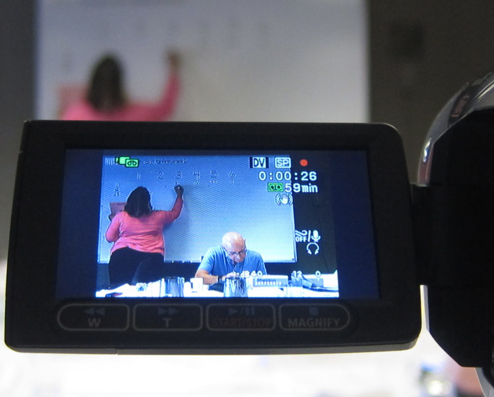Photo taken at conference of a camera videotaping a session