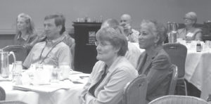Photo of a group of people sitting and listening at The Uniform Bar Examination: Moving Forward meeting
