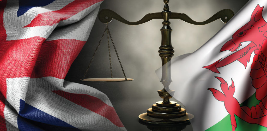 photo collage of scales of justice, flag of England and flag of Wales to portray the theme of the article