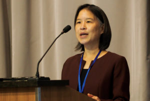 Photo of Nina Chang, NCBE, speaking at a podium