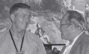 Photo of Alan Odgen (left) talking with Bob McMillan at the regional informational meeting for six states in the Northeast