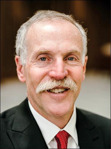 Portrait photo of Robert W. Adler