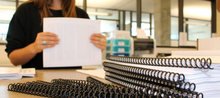 Photo of employees making the Testing Booklet
