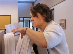 Photo of Ellen Embertson filing papers